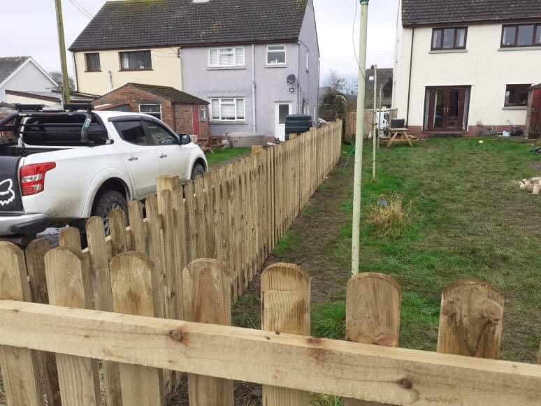 Wooden Picket Fence around garden